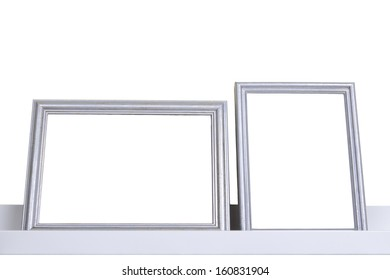 silver frames on the shelf, isolated