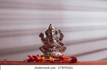 Silver Ganapathi / Ganesha Idol decorated with flowers for Ganesh Chaturthi