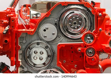 Silver gears in red transmission box machine