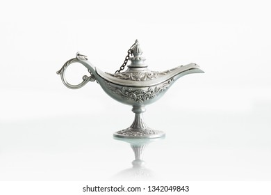 Silver genie lamp isolated on white background