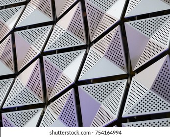 silver geometric steel cladding with angular patterns