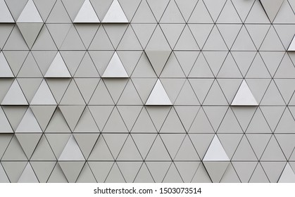 Silver geometric wall background with triangles.