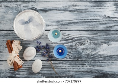 Silver gift with bow, lavender flower, blue lit candles on wooden background - Shutterstock ID 707170999