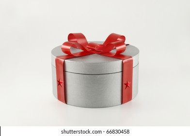 Silver gift box with red ribbon - White background