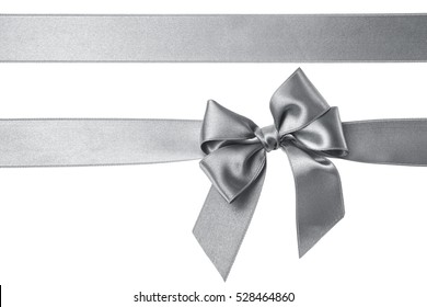 Silver gift ribbons and bow isolated on the white background