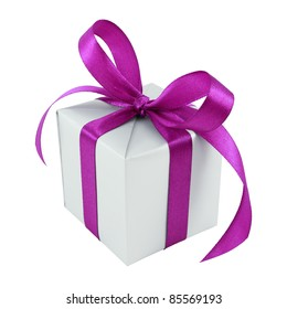 Silver gift wrapped present with purple satin bow isolated on white