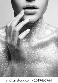 Silver Girl. Beautiful Woman with Sparkles on Body. Black and white Fashion Portrait
