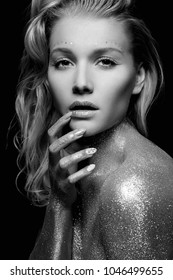 Silver Girl. Black and White beauty Portrait of Beautiful young Woman with Sparkles. Girl with Art Make-Up and curl Hair