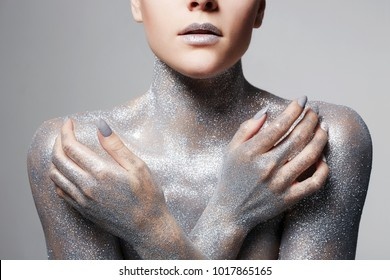 Silver Girl. Portrait of Beautiful Woman with Sparkles on her Lips and Body. Girl with Art Make-Up