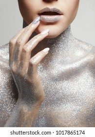 Silver Girl. Portrait of Beautiful Woman with Sparkles on Body. Girl with Art Make-Up