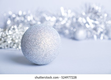 Silver glitter ball on silver background. Christmas and new year card