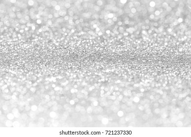 Silver glitter christmas abstract bokeh background. Blur bokeh background.