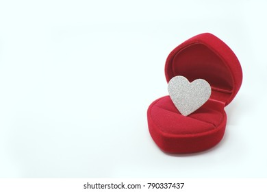 Silver glitter heart in wedding ring box. Valentines day present concept