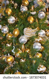 Silver and Gold Balls Christmas Card Background on Pine Tree
