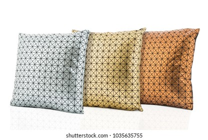 silver, gold and bronze geometric patterned cushions isolated on white background