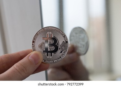 Silver and gold coins of bitcoin.