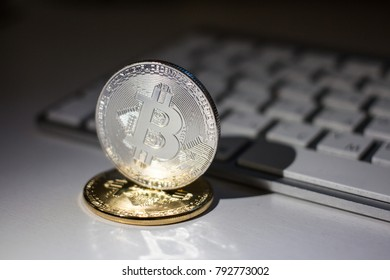 Silver and gold coins of bitcoin