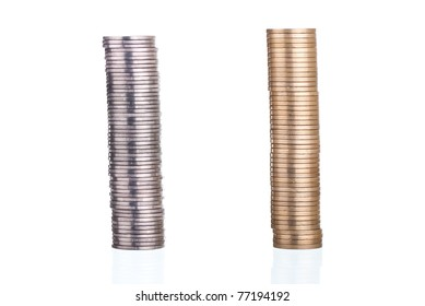 Silver and gold coins stacks on white