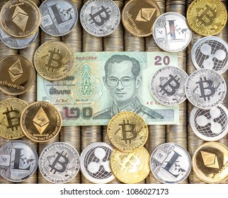 Silver Gold Crypto coins Ethereum ETH, Ripple XRP, Litecoin LTC, bitcoin BTC. Paper bills Thai baht. Metal coins, close-up view from the top, crypto currency exchange of money.