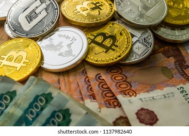 Silver Gold Crypto Coins litecoin LTC, bitcoin BTC, ripple XRP, dash . Russian ruble. Metal coins are laid out in a flat background, close-up view from the top, crypto currency exchange of money.