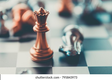 silver and gold knight on chess board. Chess knights head to head.Business concept opponent in business . or  Business Cooperation