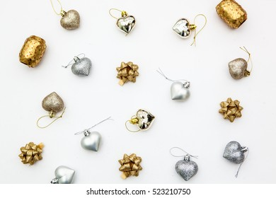 silver and golden  assortment ornament.White background.Flat lay