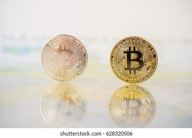 Silver and Golden bitcoins with reflex background. Bit coin cryptocurrency banking money transfer business technology
