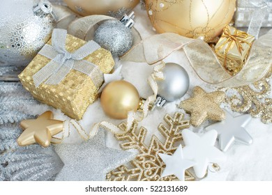 Silver and golden Christmas decorations ans gift boxes close up