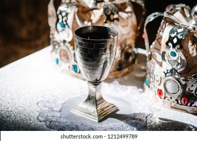 Silver, Golden cup of wine on the table in church. Communion. Close up. Divine Liturgy.