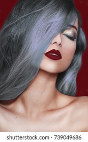 Silver hair. Fashionable hairstyle. Fashion style. Beautiful model girl with elegant hairstyle . Woman with red lips Cosmetics, beauty, make-up. Fashion Brunette Model Portrait .