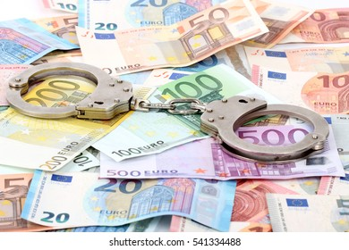 silver handcuffs on many large euro notes
