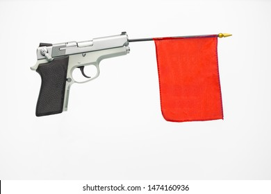 "Silver handgun with a red flag extending from the barrel on white background. Concept ""Red Flag Law"""