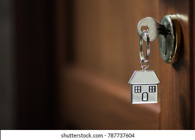 Silver house key in a door