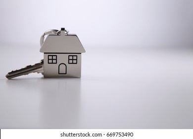 silver house shape key ring on the white background