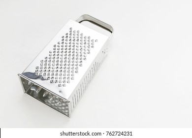 Silver iron grater isolated on white background.
