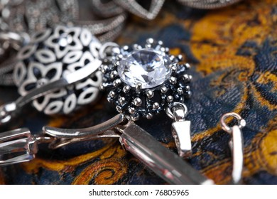 Silver Jewelery over background