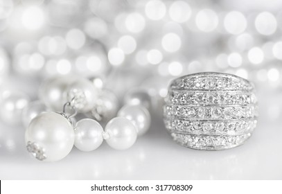 Silver jewelry with pearls and diamonds.
