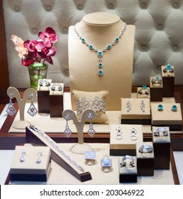 silver jewelry at showcase of jewelry store