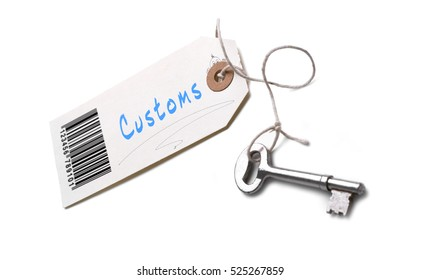 A silver key with a tag attached with a Customs concept written on it.