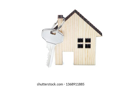 Silver key with wooden house isolated on white background