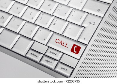 Silver keyboard with phone icon and CALL text on keys. Telemarketing concept.
