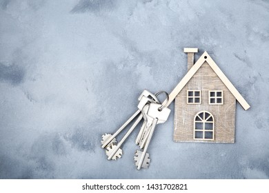 Silver keys with house symbol on grey background