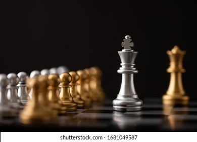 Silver king and gold queen the leader of the chess in the game on board.