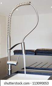 Silver kitchen faucet in a modern kitchen