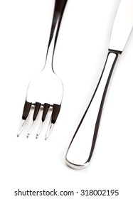silver knife and fork on a white background closeup