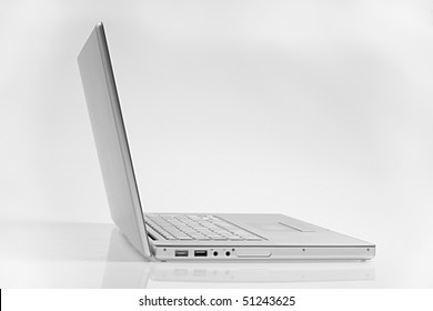 silver laptop isolated on white background with clipping path. side view. clipping path saved