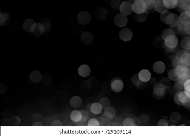 Silver lights bokeh defocus abstract background. Silver Festive Christmas. Glitter twinkled bright background.