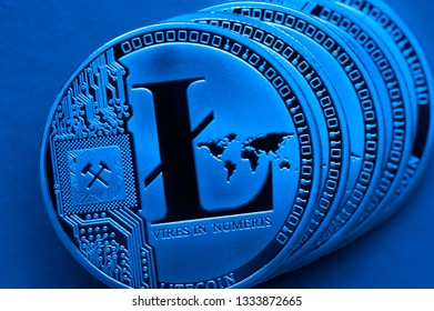 Silver litecoin coins, close-up. Cryptocurrency concept, e-banking