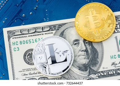 Silver Litecoin & Gold Bitcoin coins on 1 dollar banknote with blue circuit board background. Business and Technology concept. Digital currency physical metal litecoin coin - Virtual cash concept.