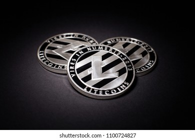 Silver Litecoin (ltc) coins on a black background